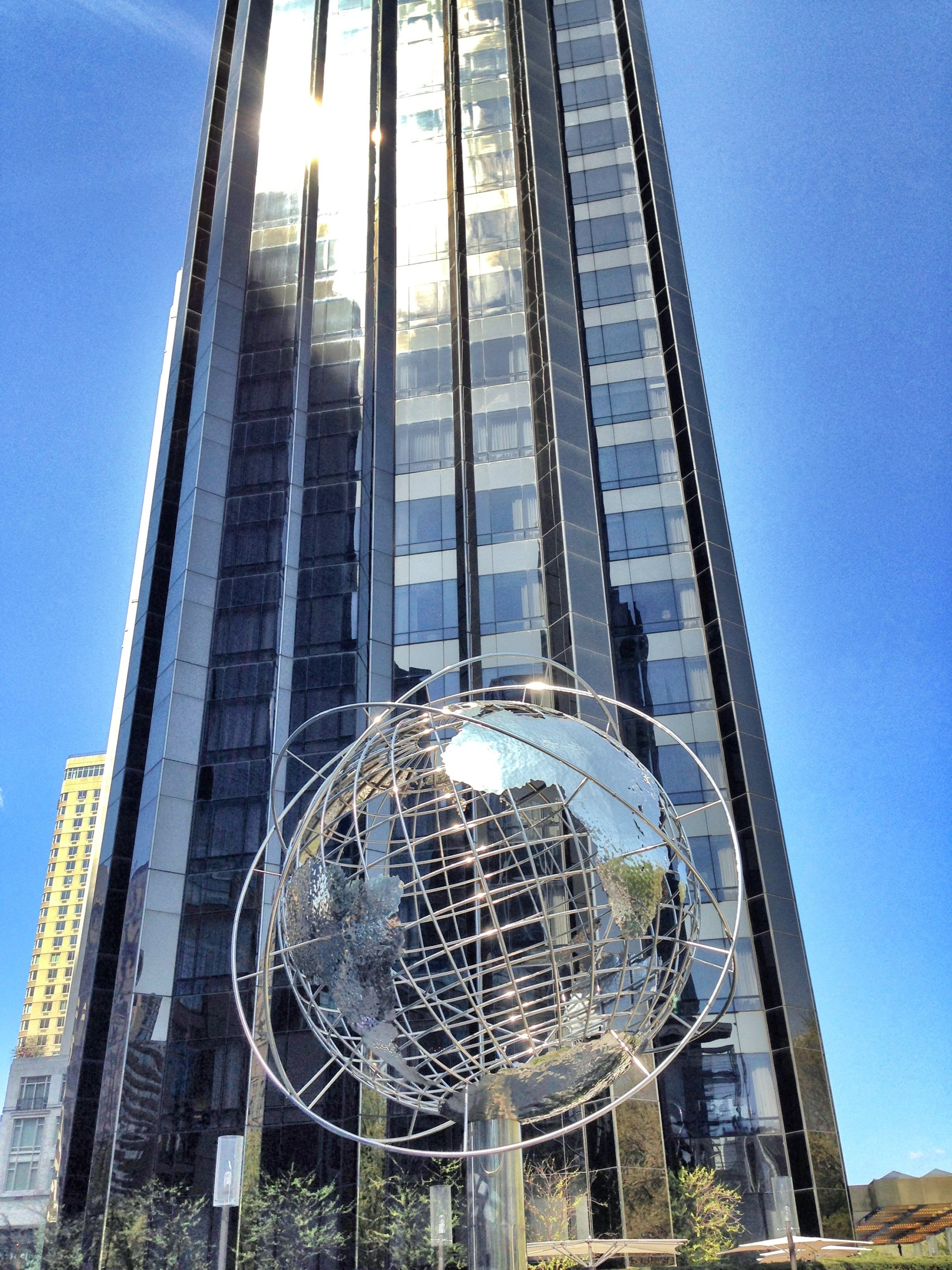 In front of trump tower with a unisphere knockoff