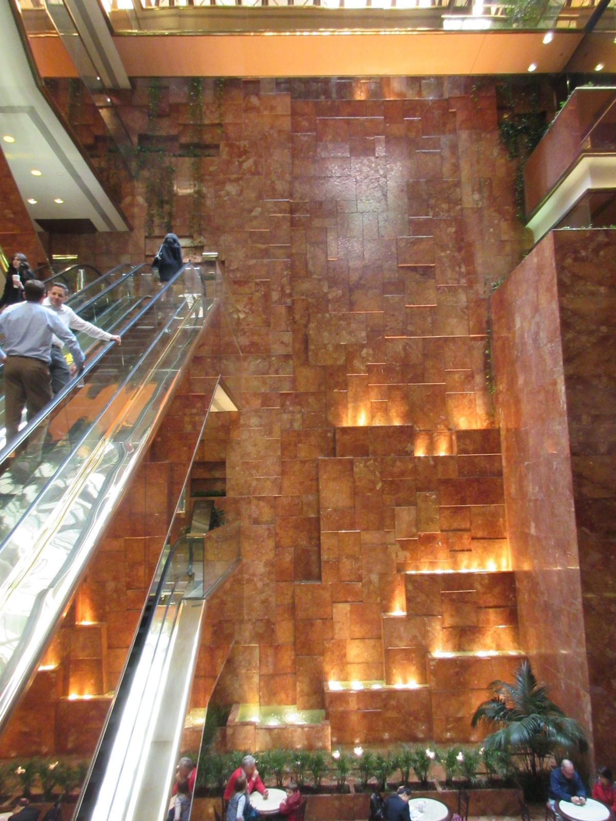 Paul Goldberger once praised the escalator- and waterfall-lined atrium of the Trump Tower. Inside the atrium are several eateries, including the Trump Bar, Trump Grill, Trump Cafe, and Trump's Ice Cream Parlor. (William Menking)