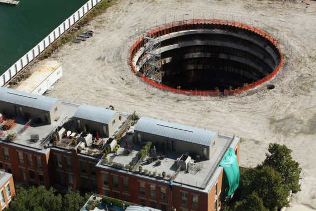 Aerial photo of a deep, dark hole in a construction site