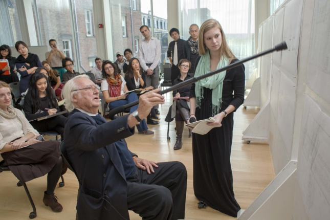 Richard Meier visits a studio to discuss an assignment students interpreted the architect's designs in drawings. (Courtesy Cornell University)