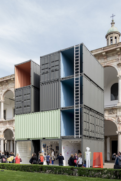 Piero Lissoni used shipping containers to create space for a Haitian photography exhibition that discussed the concept of home in poverty-stricken Haiti.