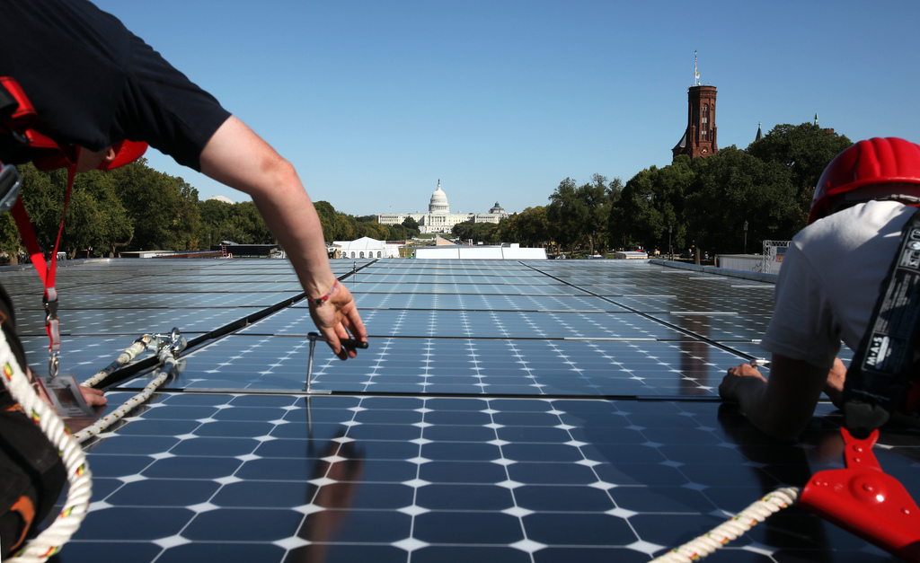 Image of solar panels ahead of U.S. Capitol building