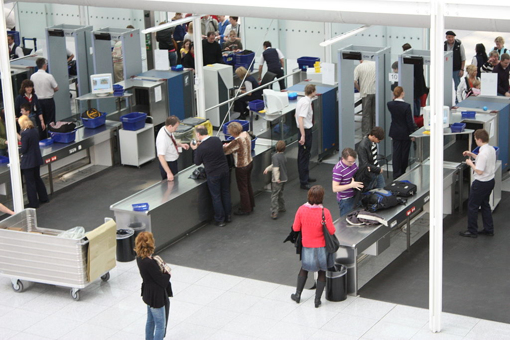 Image of people going through a security checkpoint