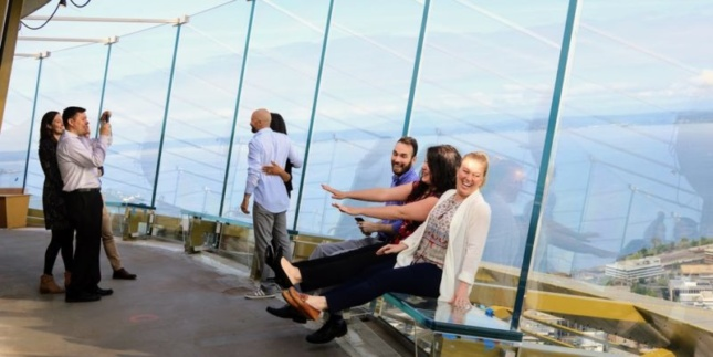 Photo of visitors to the exterior observation deck at the Seattle Space Needle