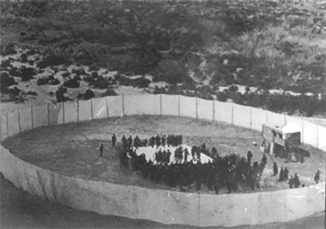 Photograph of the 1896 heavyweight prize fight in boxing, taken from the escarpment above the bed of the Rio Grande River where the fight was staged.