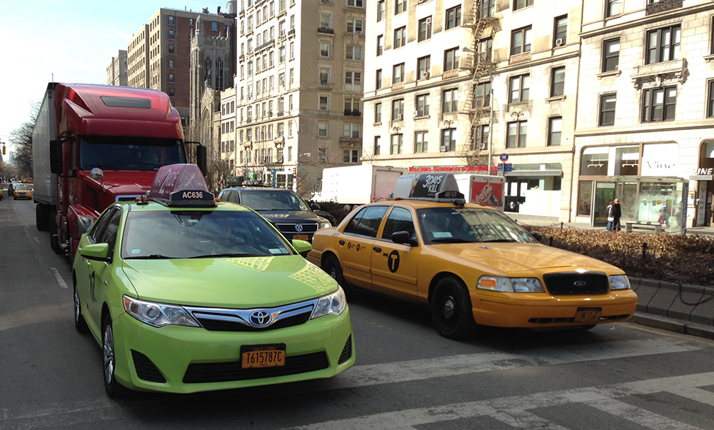 Taxicabs of New York City. Medallion taxi (yellow) on the right. Boro taxi (apple green) on the left. (Z22, Via Wikimedia Commons)
