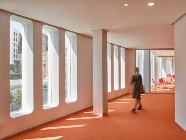 Curvy windows and bright orange carpeting lends some spaces in the Forum a throw-back feel.