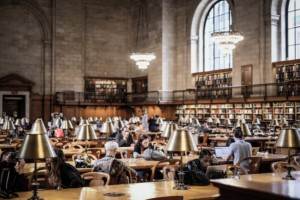 photo of people sitting in the new york public library main reading room