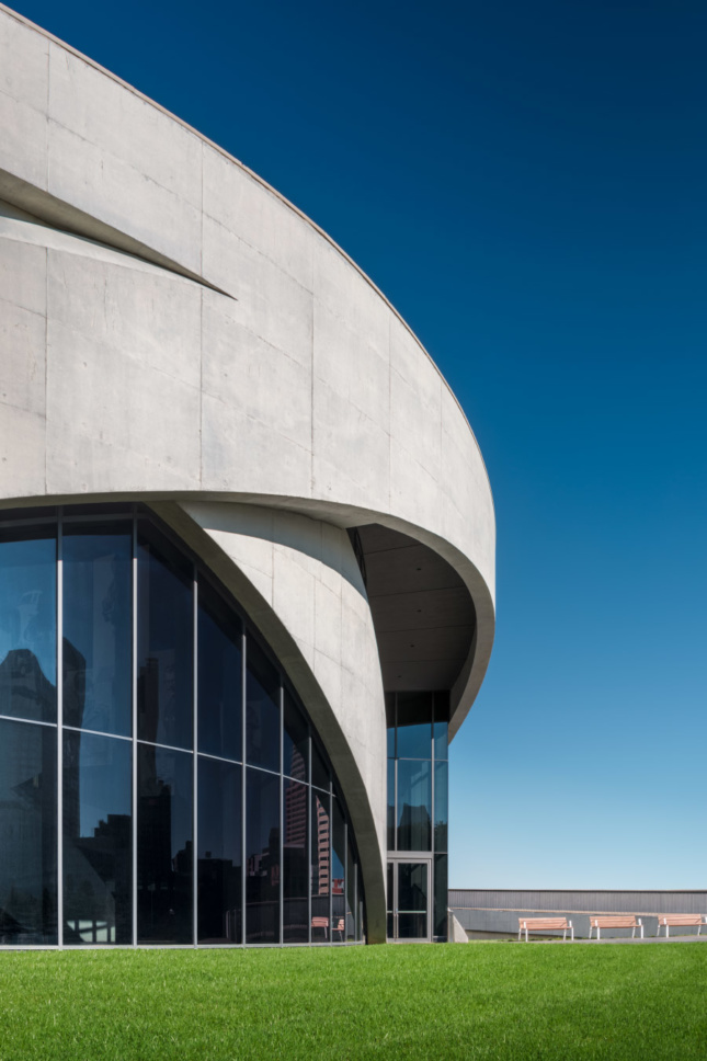 "Structural concrete wraps both the interior and exterior of the museum, ""lifting"" the rooftop sanctuary plaza."