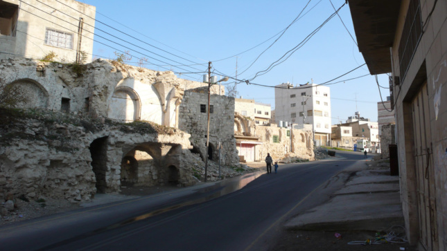 "The remnants of Palestinian homes that were bulldozed in 2004 to create the road known as ""Worshippers Way,"" which connects the Israeli settlement Kiryat Arba to religious sites in the Old City of Hebron. These houses and other similar buildings were the subject of a legal battle argued in the Israeli High Court, brought by Palestinian landowners and the city, that sought to have the houses protected as examples of Mamluk-Ottoman architecture."