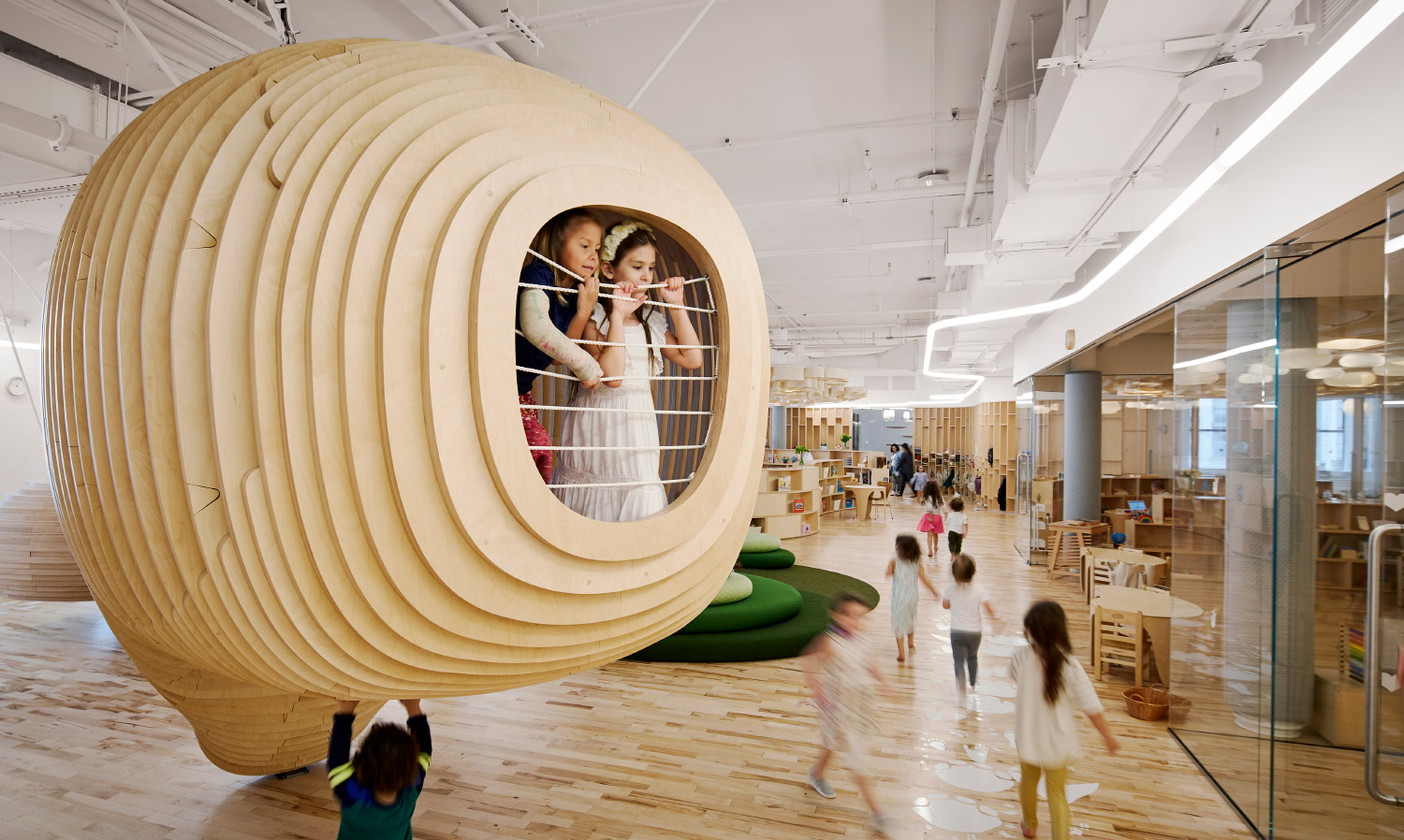 The BIG-designed WeGrow features a variety of occupiable vantage points for children to explore.