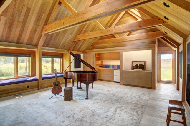 The music room with wood trusses above, refurbished by Martin Architects