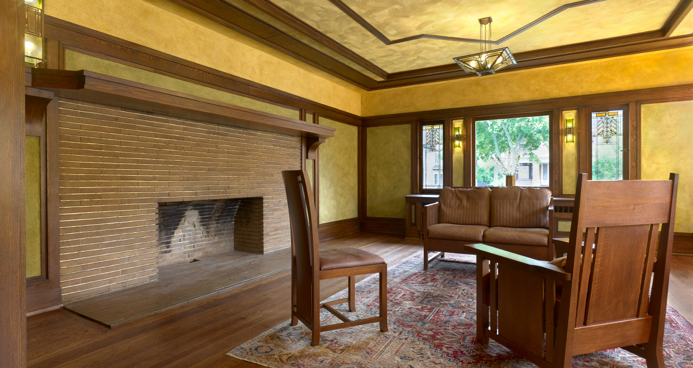 Wide angle of the living room, which includes a central hearth.