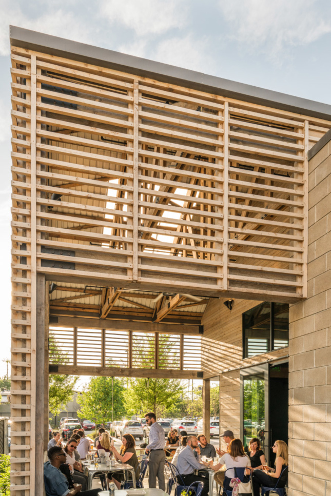 Louvers provide ventilation on the porch while revealing the unfinished wood trusses within.