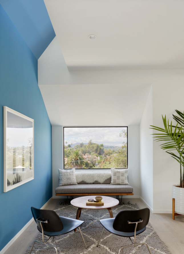 The sloped interior of Urban Operations' speculative homes direct views to the sweeping views surrounding each building.