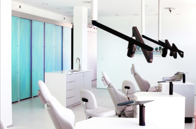 Sharif, Lynch: Architecture's kid-friendly orthodontics office in Santa Monica features dichromatic glass wall panels that glide on glass sliding-door hardware by C.R. Laurence and a custom-made sink basin designed by Sharif, Lynch principal Mohamed Sharif.
