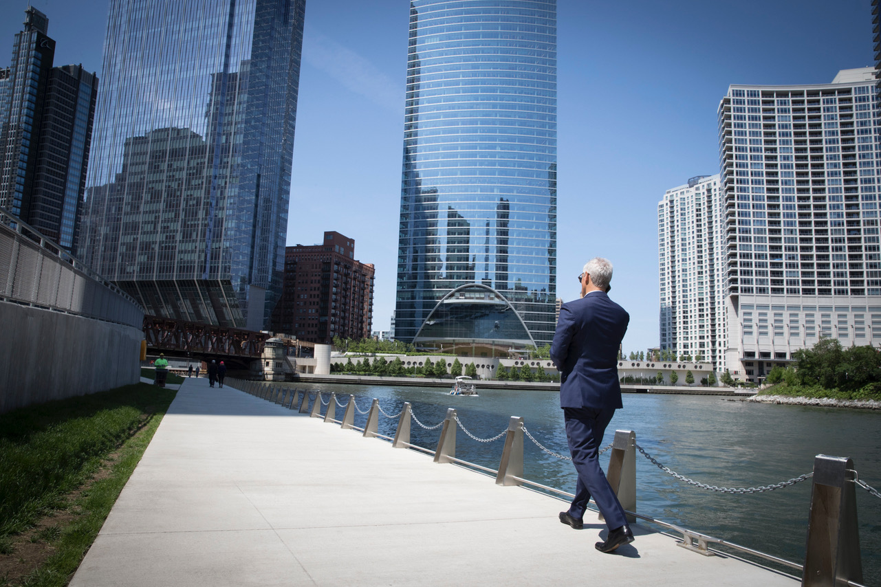 Mayor Rahm Emanuel takes a moment to himself on the Chicago Riverwalk during a visit from the mayor of Hamburg, Germany.