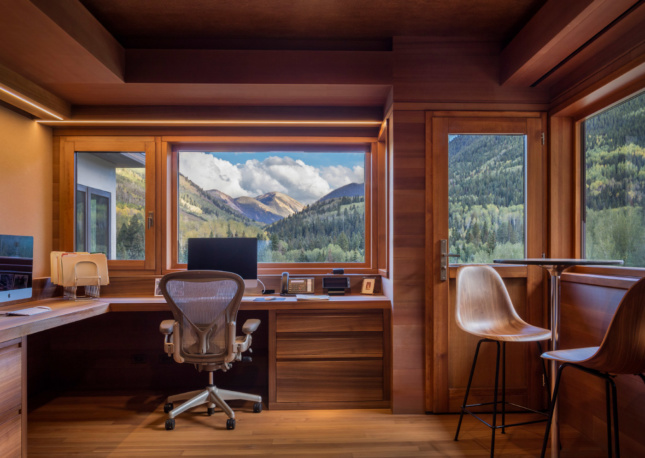 The couple's studio sits at the highest point in the home. Windows by Albertini offer seamless views of the valley.
