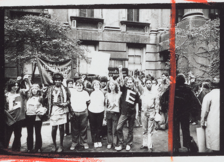 Members of the Gay Liberation Front with GAY POWER shirts at City Hall, New York in 1969-1972