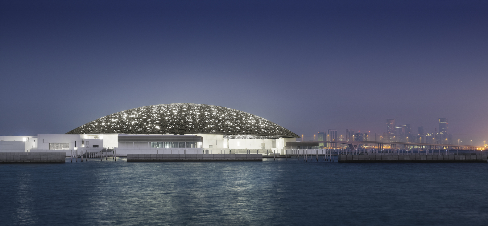 Exterior night view of the Louvre Abu Dhabi