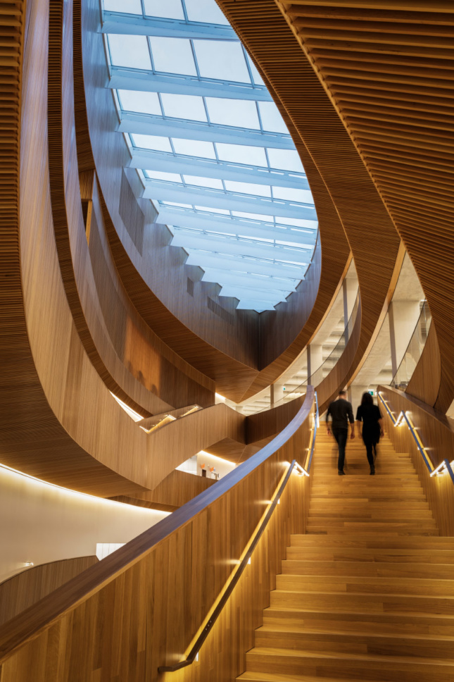 The edges of each floor have been carved out around an 85-foot-tall central atrium.
