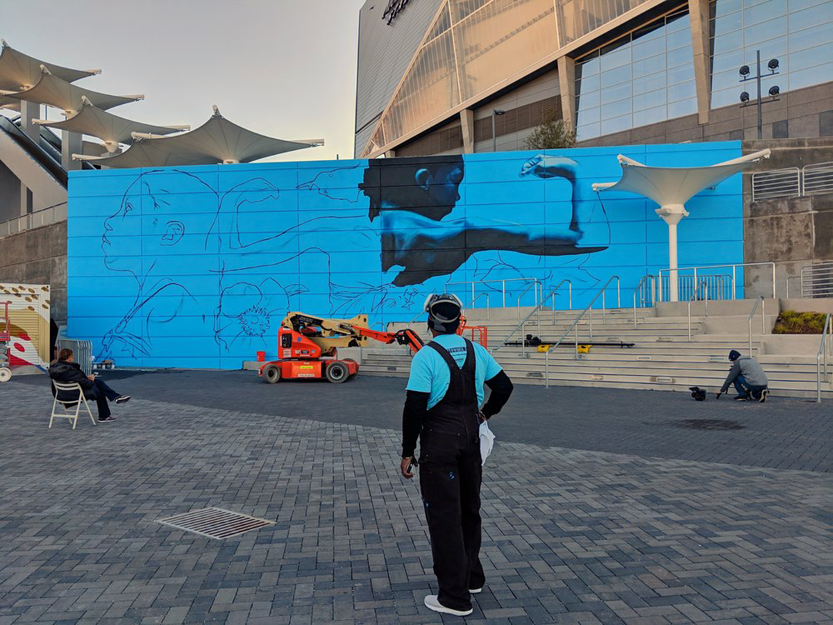Photo of mural being installed in Atlanta for Off the Wall and the Atlanta Super Bowl HostCommittee
