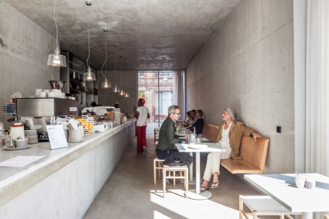 Inside the exposed concrete interior of Kantine, diners are treated to a reasonable, if linear, space.