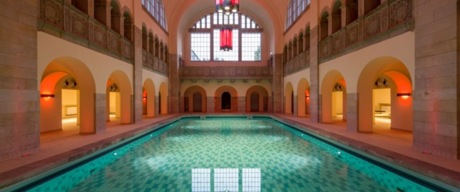 The sweeping pool is housed in a centuries-old building.