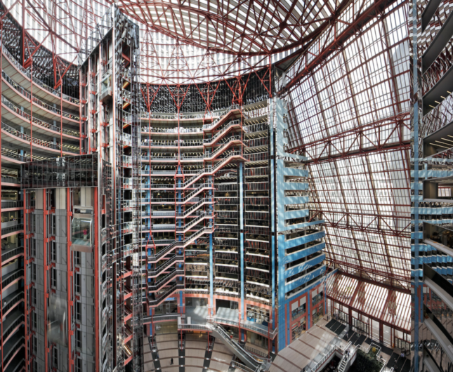 Photo of the 160-foot atrium of Helmut Jahn's 1985 James R. Thompson Center.