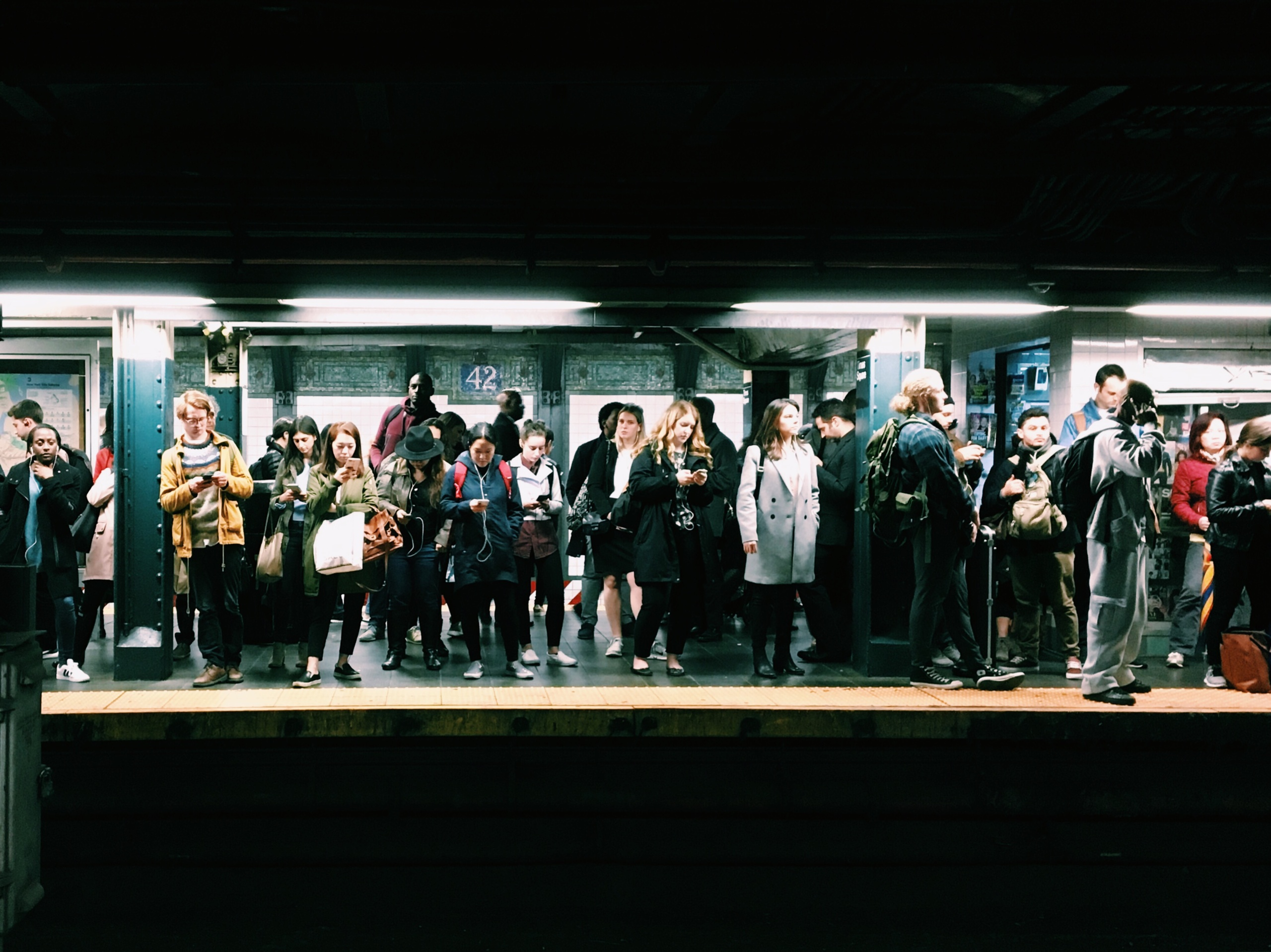 Photo of people waiting for the subway