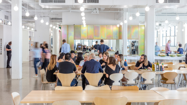 A full-sized cafeteria is set against chromatized steel cabinets.