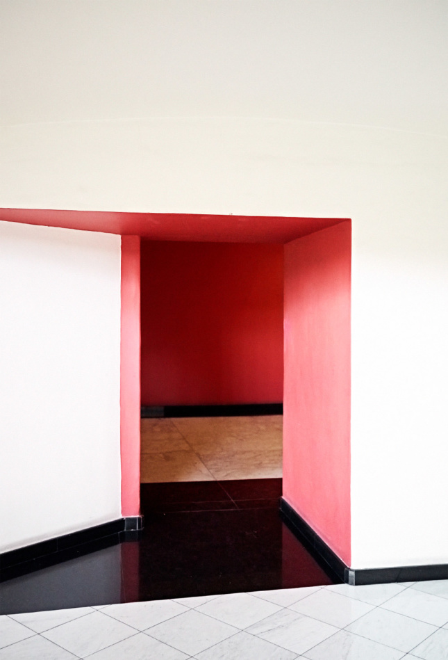 Photo of a white and pink hallway