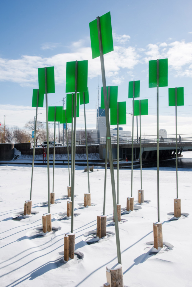 Photo of green signs anchored to piers