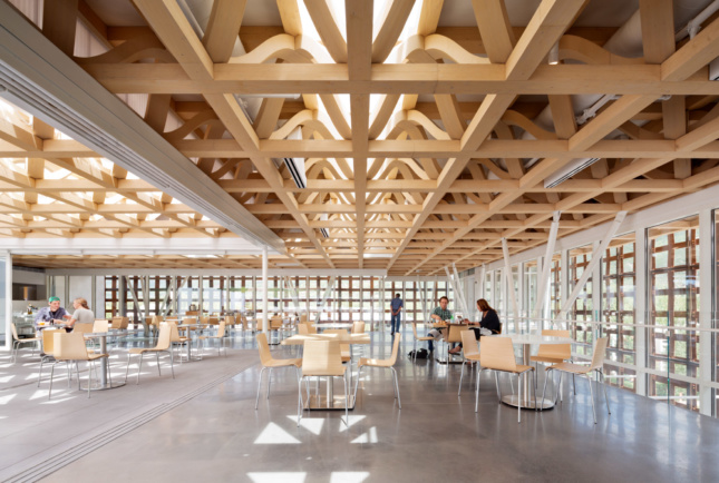 Photo of a cafe area and ceiling trusses.