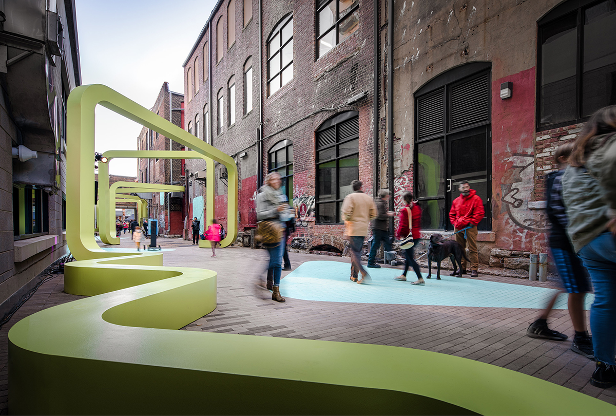 Photo of alleyway with green curvy seating