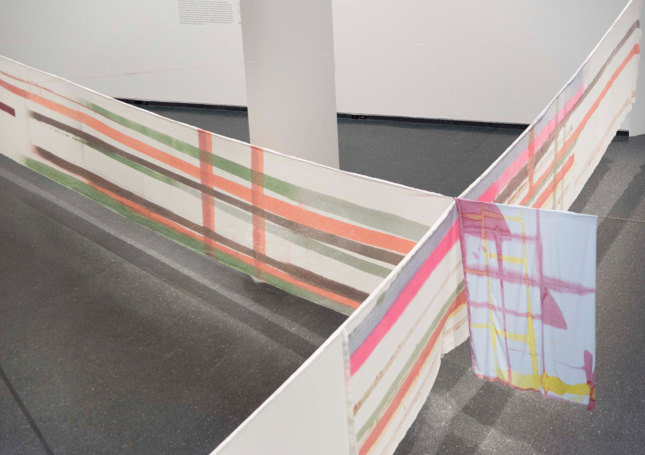 Photo of textile artworks stretched in the Brooklyn Museum