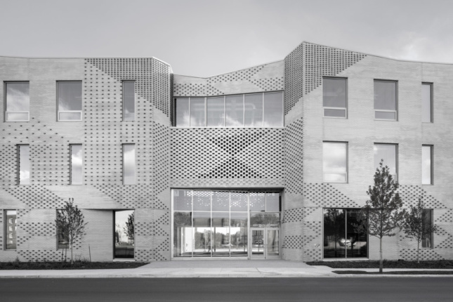 Black and white photo of a brick school facade