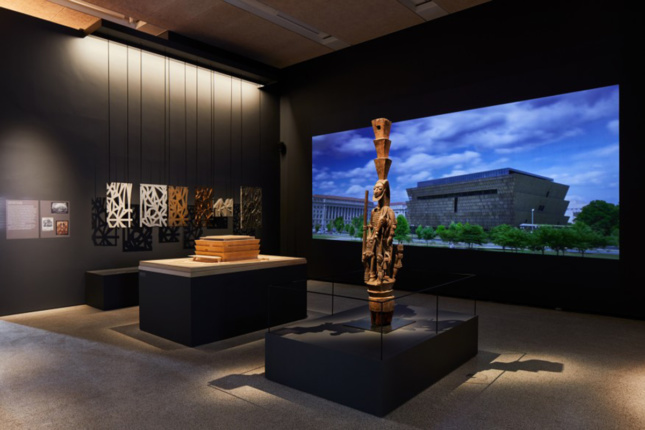 Photo of exhibition at the Design Museum showcasing Adjaye's Smithsonian National Museum of African American History and Culture