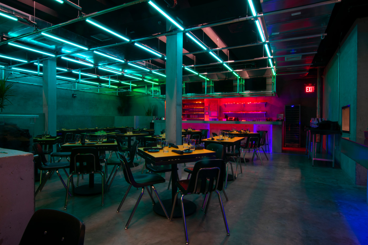 Photo of a neon-lit restaurant interior