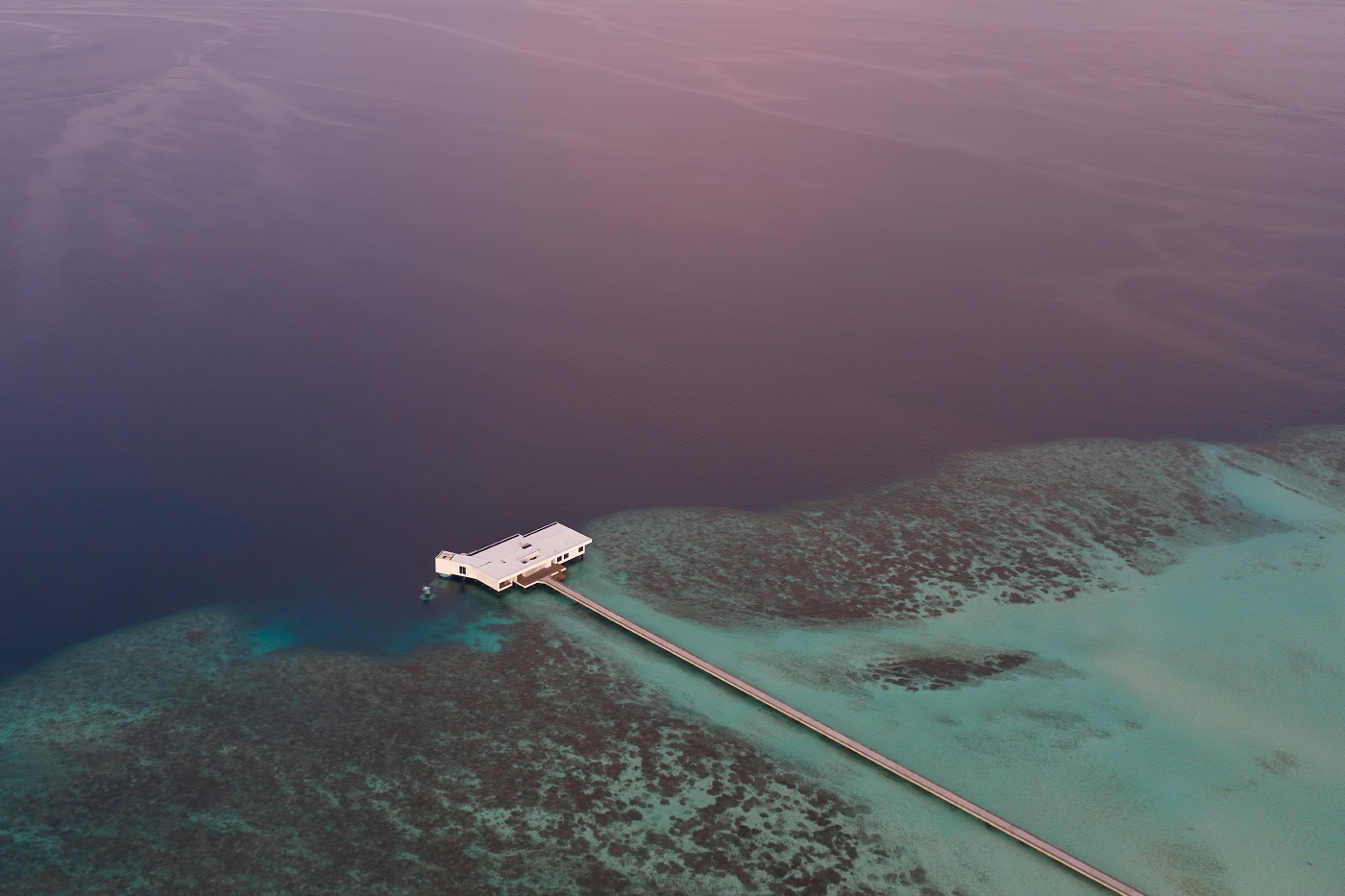 Photo of a long pier and a resort in the ocean