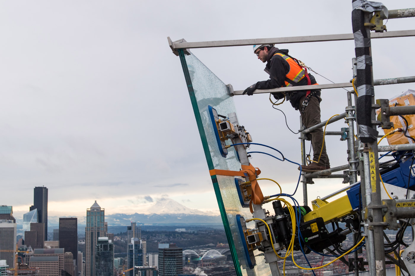 Photo of a construction worker and glass panel