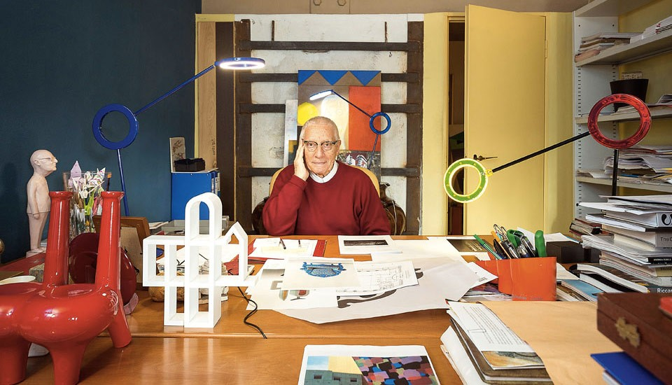 Photo of Alessandro Mendini at his work desk