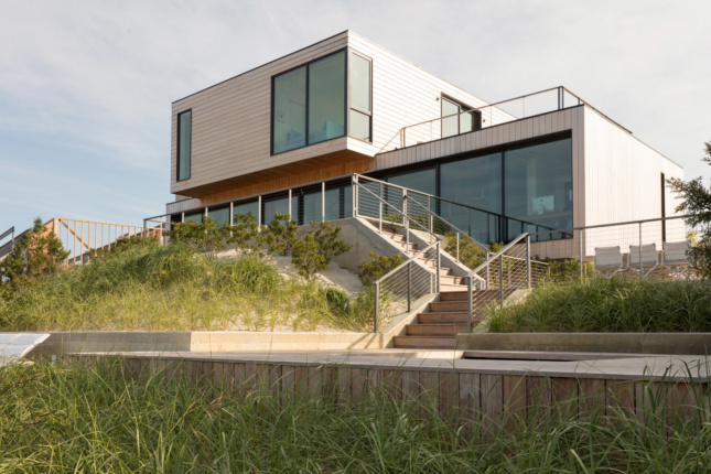 A beach house elevated on dunes
