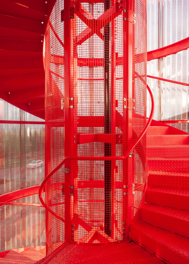 Photo of bright red fire escape spiral staircase