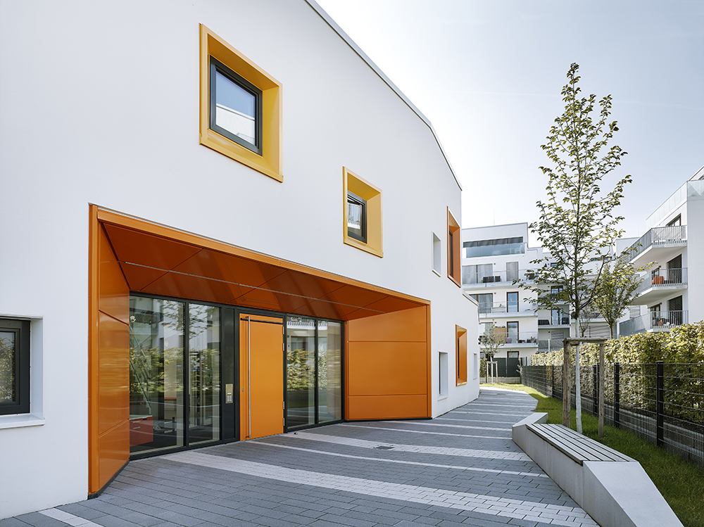 This kindergarten by 1100 Architect features a high-performance insulated facade