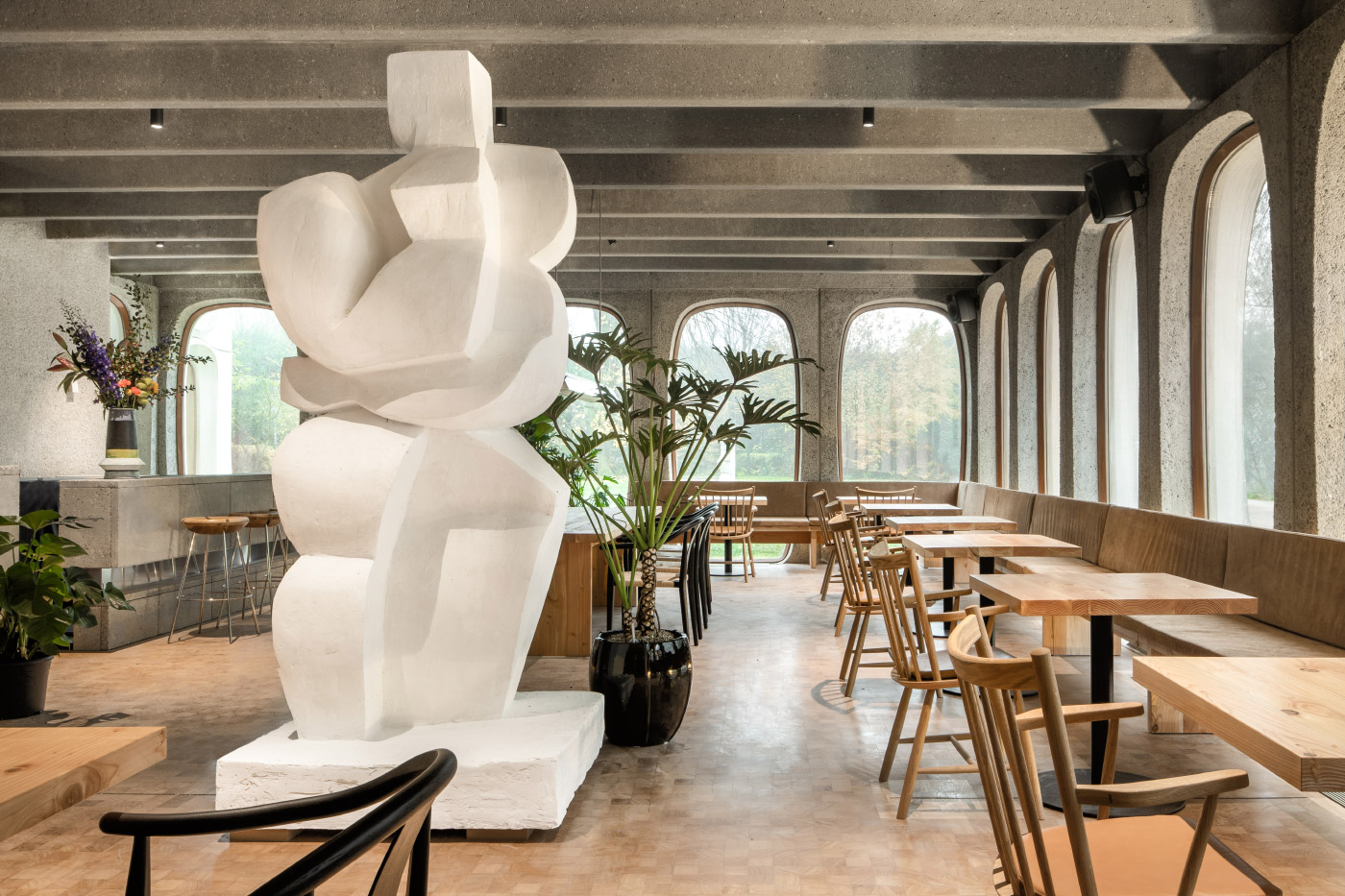 A white statue in a cafe area