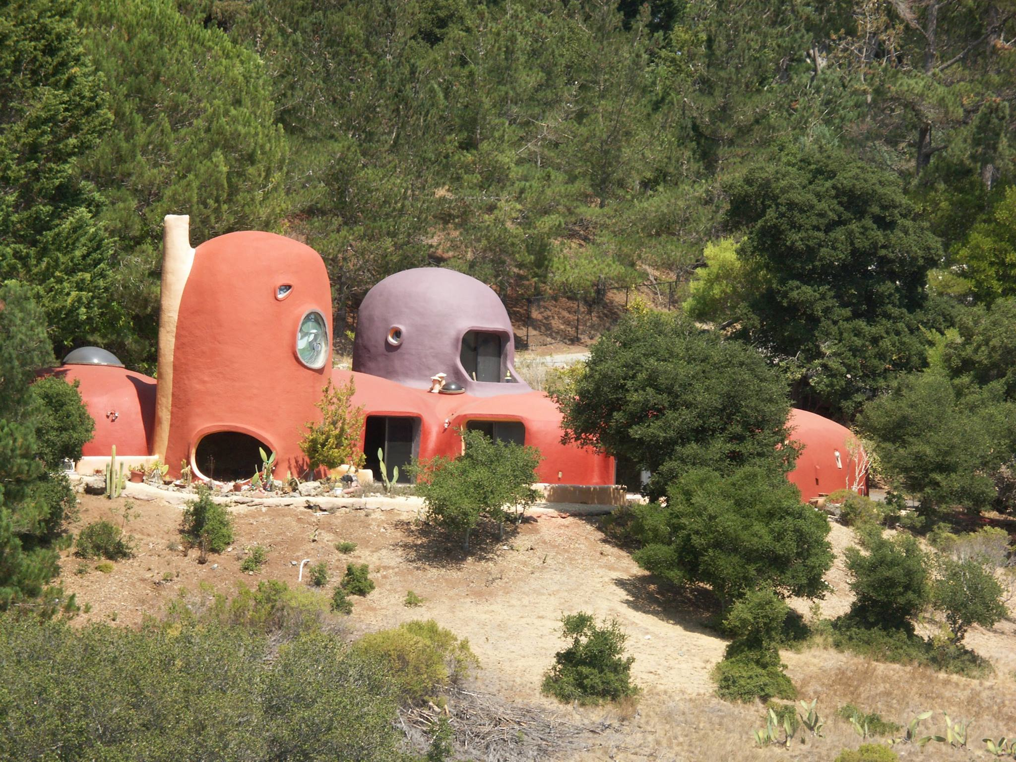 A blobby orange home in the hills