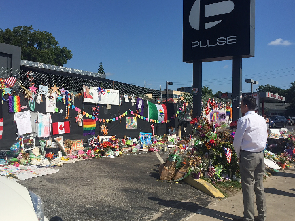 Photo of Florida Governor looking at Pulse nightclub memorial