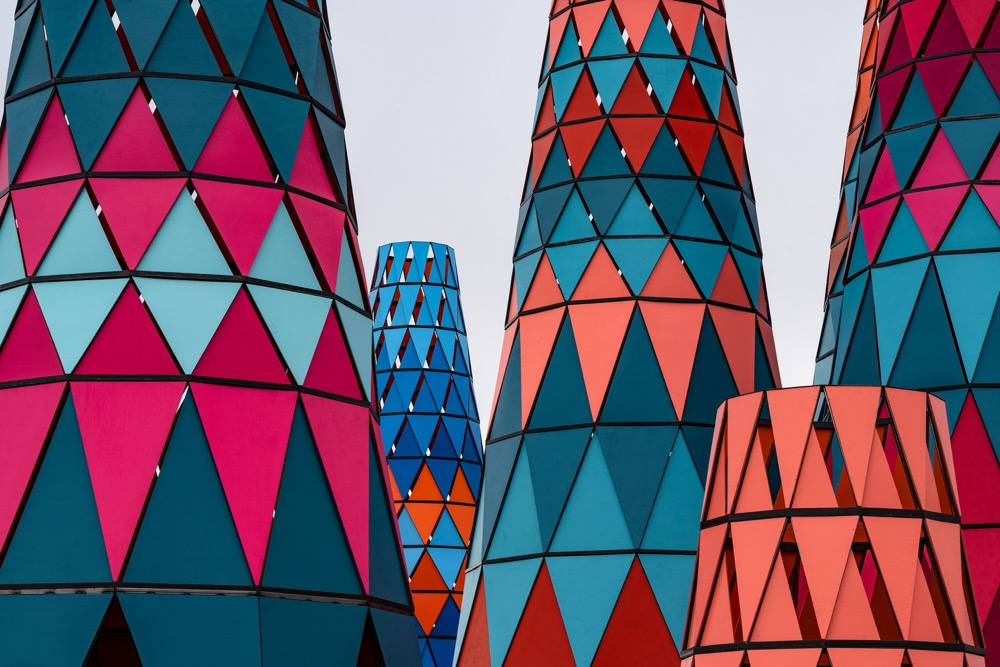 Photo of brightly colored conical towers