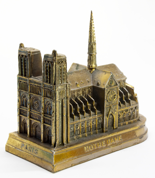 Photo of a metal model of Paris's Notre Dame Cathedral